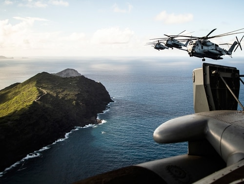 Marines fly near the shores of Kalaeuila in CH-53E Super Stallion helicopters over the Island of Oahu, Hawaii, on July 3, 2019. (Cpl. Eric Tso/Marine Corps)