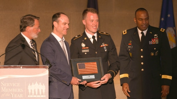 SPC. Shayn Lindquist receiving the Army Times Soldier of the Year award from Sen. Gary Peters, D-Mich.; Andrew Tilghman, executive editor of Military Times; and Maj. Gen. Kevin Vereen, Provost Marshal General and commanding general U.S. Army Criminal Investigation Command.