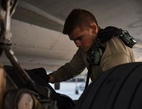 U.S. Air Force Senior Airman Gilbert, 380th Expeditionary Aircraft Maintenance Squadron E-3 AWACS Sentry crew chief, inspects a tire of a KC-10 during a pre-flight inspection at Al Dhafra Air Base, United Arab Emirates, Dec. 20, 2018. The crew chief's extensive list of responsibilities including for pre-, post- and thru-flight checks, and well as various inspections, allows them to fully understand their vital role, making them jacks-of-all-trades when it comes to repairing the aircraft. (Senior Airman Mya M. Crosby/Air Force)