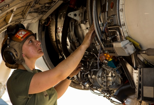 U.S. Marine Corps Lance Cpl. Jessica Kerr, a plane captain with Marine Tactical Electronic Warfare Squadron (VMAQ) 2, 2nd Marine Aircraft Wing conducts maintenance on a Marine Corps EA-6B Prowler assigned to VMAQ-2, prior to a flight during Exercise Northern Edge 15 at Eielson Air Force Base, Alaska, June 15, 2015. Northern Edge is Alaska's premier joint training exercise designed to practice operations, techniques and procedures as well as enhance interoperability among the services. Thousands of participants from all services, Airmen, Soldiers, Sailors, Marines and Coast Guardsmen from active duty, Reserve and National Guard units are involved. (U.S. Marine Corps photo by Cpl. Suzanne Dickson/Released)