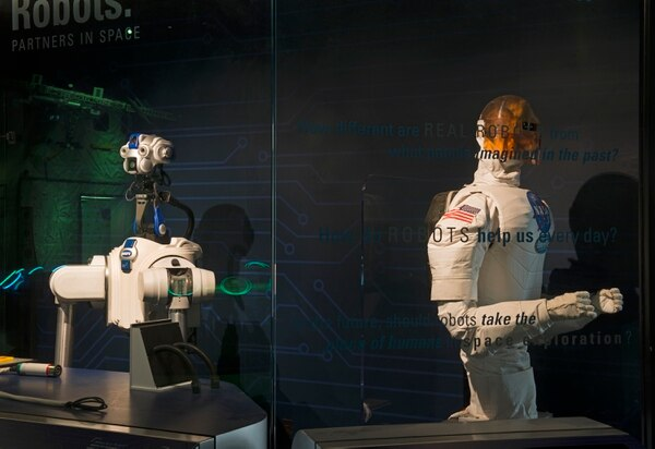 "The DARPA Autonomous Robotic Manipulation robot ""Robbie"" and the NASA/DARPA Robonaut 1A on display in the Moving Beyond Earth gallery at the National Air and Space Museum. (Mark Avino/ Smithsonian Institution)"