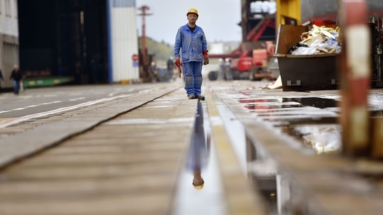 A worker stands at the site of French shipyard STX in Saint-Nazaire, western France, in September 2017. The shipyard is at the center of a much-hyped European industry consolidation wave that has yet to pick up steam. (Loic Venance/AFP via Getty Images)