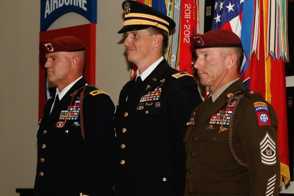 Maj. Gen. James J. Mingus, 82nd Airborne Division commanding general, Command Sgt. Maj. Arthur Burgoyne Jr. and Capt. Travis A. Johnson, assigned to the 60th Medical Detachment, North Carolina National Guard, attend an award ceremony at the Hall of Heroes on Fort Bragg, Oct. 9, 2019. (Spc. Justin W. Stafford/Army)