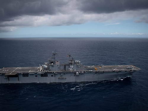 Amphibious assault ship Essex]steams in a multinational formation off the coast of Hawaii August 21, 2020 during the Rim of the Pacific exercise. (MC2 Jenna Dobson/Navy)
