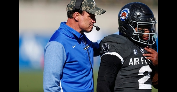 In this Oct. 14, 2017, file photo, Air Force Falcons head coach Troy Calhoun, left, confers with quarterback Arion Worthman in the second half of an NCAA college football game at Air Force Academy, Colo. (David Zalubowski/AP)