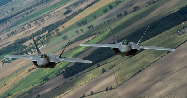 Two F-22 Raptors fly over Poland in August. (Senior Airman Joshua Magbanua/U.S. Air Force)