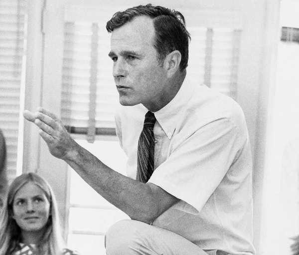 Rep. George H.W. Bush, R-Texas, talks with a group of young people at a rally in Houston, Texas, Oct. 9, 1970. (AP Photo)