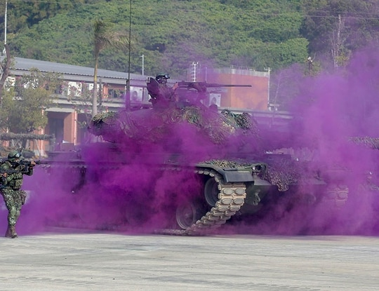 Soldiers take part in a military exercise in Kaohsiung, southern Taiwan, Wednesday, Jan. 15, 2020. Taiwan military started a two-day joint forces exercises on Wednesday to show its determination to defend itself from Chinese threats. (AP Photo/Chiang Ying-ying)