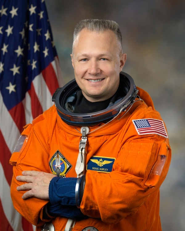 In this Feb. 11, 2011 photo provided by NASA, astronaut Douglas Hurley poses for a photo. Hurley is one of four veteran astronauts selected to fly the first commercial space missions, NASA announced, Thursday, July 9, 2015. (Bill Stafford/NASA via AP)