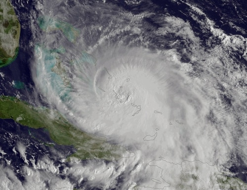 This satellite image taken Friday, Oct. 2, 2015 at 8:45 a.m. EDT, and released by the National Oceanic and Atmospheric Administration (NOAA), shows Hurricane Joaquin of the Bahamas. The Category 4 storm ripped off roofs, uprooted trees and unleashed heavy flooding as it hurled torrents of rain across the eastern and central Bahamas on Friday, and the U.S. Coast Guard said it was searching for a cargo ship with 33 people aboard that went missing during the storm. (NOAA via AP)
