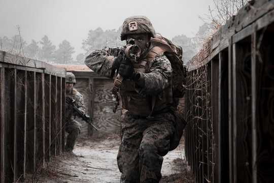 A Marine with 8th Engineer Support Battalion clears a simulated enemy cache site during a simulated live-fire event during Command Post Exercise VI (CPX) on Camp Lejeune, N.C., Feb. 2, 2021. (Lance Cpl. Zachary Zephir/Marine Corps)