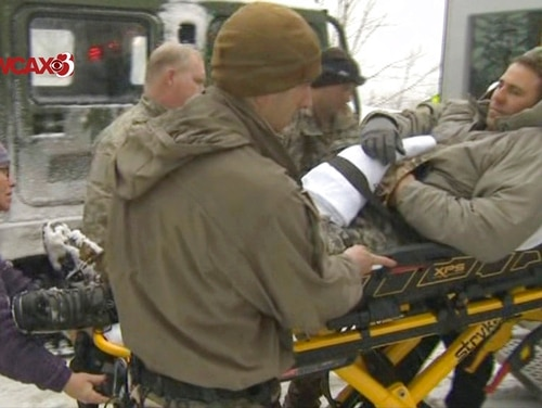 In this still image from video provided by WCAX-TV Channel 3, a soldier is evacuated after an avalanche March 14 near Easy Gully in Smugglers Notch, Vermont. Six soldiers were injured in the avalanche. (WCAX-TV Channel 3 via AP)