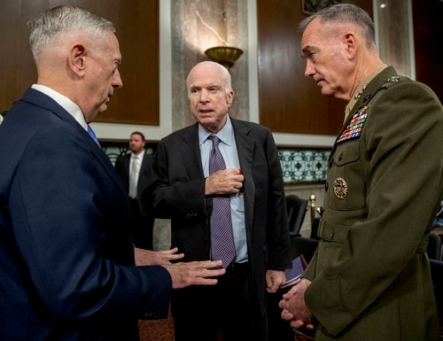 Defense Secretary Jim Mattis, left, and Joint Chiefs Chairman Gen. Joseph Dunford, right, speak with Chairman Sen. John McCain, R-Ariz., center, as they arrive to testify on Afghanistan before the Senate Armed Services Committee on Capitol Hill in Washington, Tuesday, Oct. 3, 2017. (Andrew Harnik/AP)