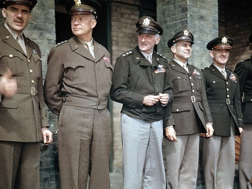 Brig. Gen. Jesse Auton; Gen. Dwight D. Eisenhower, Supreme Allied Commander in Europe; Lt. Gen. Carl Spaatz, commander of Strategic Air Forces in Europe; Lt. Gen. James Doolittle, commander of the 8th Air Force in Europe and the Pacific; Lt. Gen. William E. Kepner, commanding general of the 8th Air Force's 2nd Bomb Division; Col. Donald M. Blakeslee, in Debden, Essex, United Kingdom, 11th April 1944. These VIPs were present for the presentation of Colonel Blakeslee with the Distinguished Service Cross.
