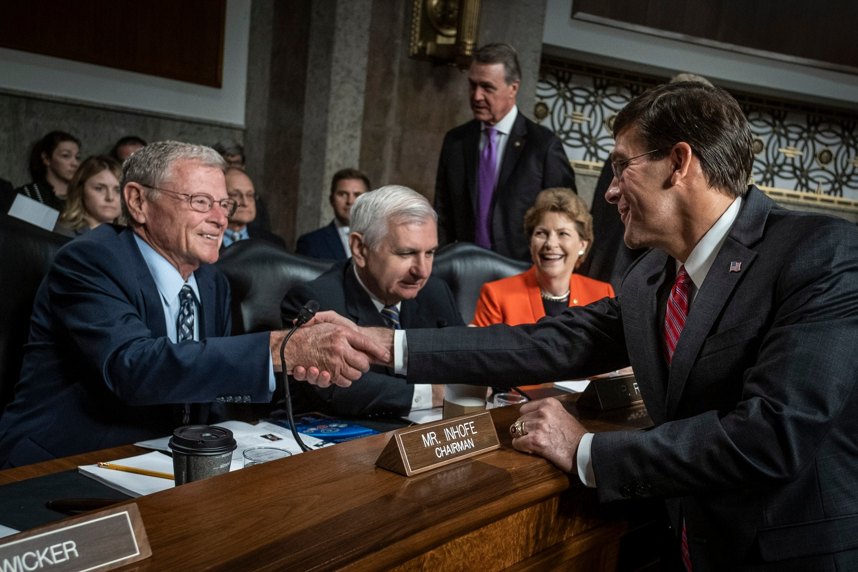 Secretary of Defense nominee, Mark Esper, shakes hands with Committee Chairman James Inhofe, R-Okal., before he testifies before the Senate Armed Services Committee during his confirmation hearing on July 16, 2019 in Washington, D.C. (Photo by Pete Marovich/Getty Images)