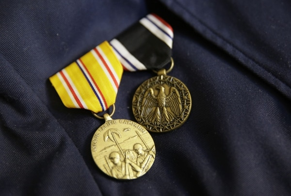 The Prisoner of War Medal, right, and the Asiatic-Pacific Campaign Medal, shown on the jacket of Bataan Death March survivor Ramon Regalado. The POW medal didn't exist until 40 years after World War II ended, and not all veterans are aware they may merit the honor. (Eric Risberg/AP)