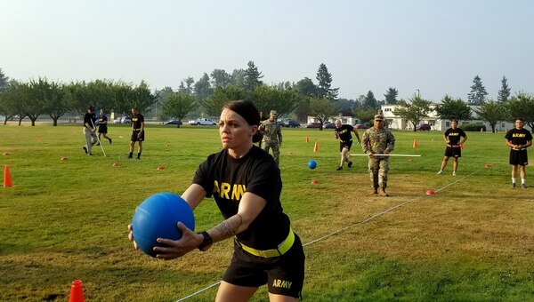 A soldier with the Washington National Guard positions a 10-pound medicine ball as part of the standing power throw test event during a pilot Army Combat Readiness Test Aug. 4, 2017, at Joint Base Lewis-McChord, Washington. (Stephanie Slater/Army)
