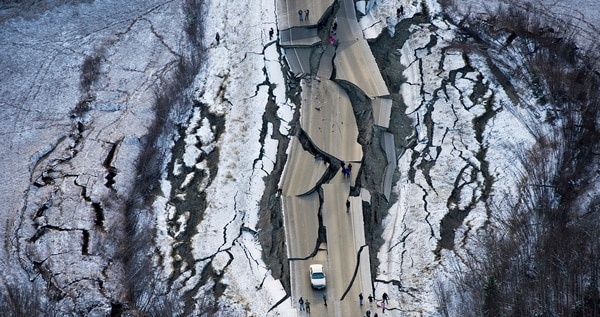 An aerial photo shows damage on Vine Road, south of Wasilla, Alaska. Gov. Bill Walker said it would take a long time to repair the damage to roads in the area. (Marc Lester/Anchorage Daily News via AP)