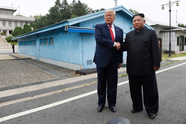 In this June 30, 2019, file photo, U.S. President Donald Trump, left, meets with North Korean leader Kim Jong Un at the border village of Panmunjom in the Demilitarized Zone, South Korea. (Susan Walsh/AP)