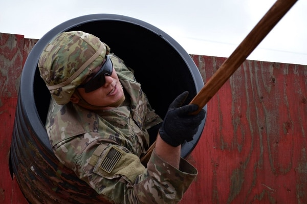 A soldier assigned to the 25th Infantry Division navigates a series of obstacles during a leadership course at Schofield Barracks, Hawaii. The Army is rolling out an update to its requirement that every soldier attend the required professional military education course before they can be promoted in a bid to grow better, well-rounded leaders. (Army)