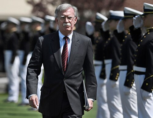 National Security Adviser John Bolton is saluted as he arrives to speak at the commencement for the United States Coast Guard Academy in New London, Conn., Wednesday, May 22, 2019. (Jessica Hill/AP)