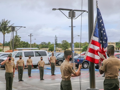 U.S. Marines assigned to Marine Corps Base (MCB) Camp Blaz conduct the first flag raising of the new command, marking the initial operation capability of the base in Dededo, Guam, Oct. 1, 2020. (Cpl. Andrew King/Marine Corps)