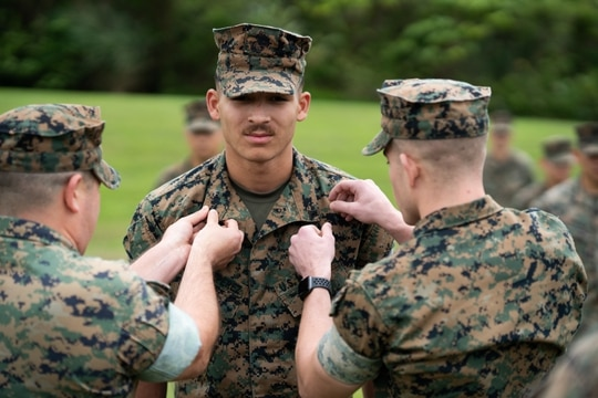 Cpl. Donovan Massieperez pins on corporal during a ceremony on Camp Courtney, Okinawa, Japan, April 1, 2020. (Lance Cpl. Jamal Norris/Marine Corps)