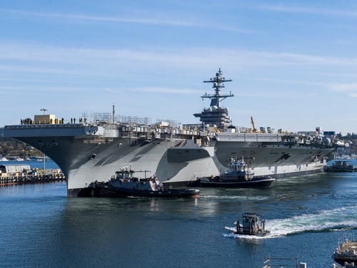 The Nimitz-class aircraft carrier Carl Vinson (CVN 70) performs docking maneuvers with aid of smaller watercraft at Naval Base Kitsap, Wash., on April 6, 2020. (Mass Communication Specialist Seaman Aaron T. Smith/Navy)