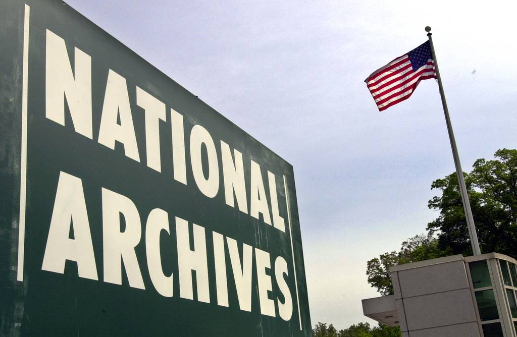 A sign stands at the entrance to the National Archives building May 6, 2002, in College Park, Md.