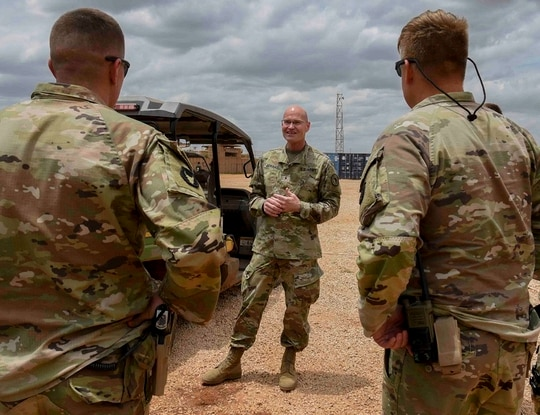 U.S. Army Brig. Gen. Damian T. Donahoe, deputy commanding general, Combined Joint Task Force - Horn of Africa, center, talks with service members during a battlefield circulation Saturday, Sept. 5, 2020, in Somalia. (Senior Airman Kristin Savage/Combined Joint Task Force - Horn of Africa via AP)