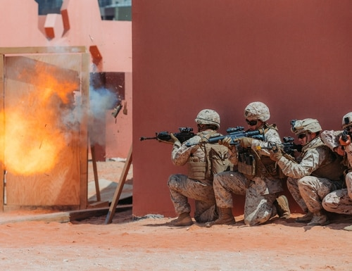 U.S. Marines with 1st Combat Engineer Battalion and a United Arab Emirates Armed Forces soldier conduct urban breaching during exercise Native Fury in the United Arab Emirates on March 17, 2020. (Cpl. Jennessa Davey/U.S. Marine Corps)
