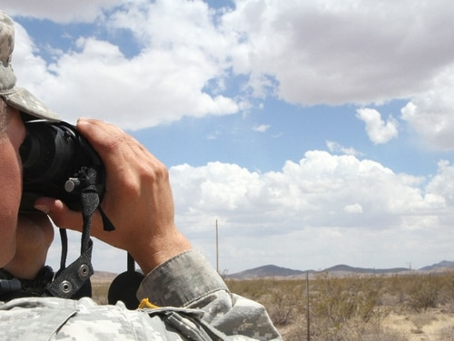 A District of Columbia National Guardsman monitors the U.S. border near Mexico in June 2014. The Pentagon has ordered more than 5,200 active-duty troops to the border as a caravan of thousands of migrants moves north. (Spc. Jennifer Amo/Army)