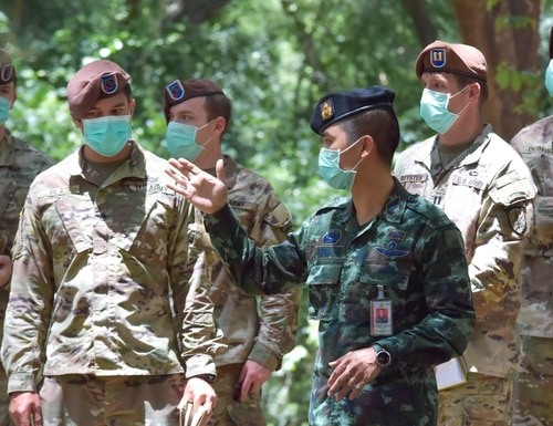 Team Healthcare Staff Sgt. Jordan Blas, Combat Advisor Team 5110, 1st Battalion, 5th Security Force Assistance Brigade, discusses a training engagement with the Royal Thai Army's Lt. Col. Takham Pratya, Aug. 20, 2020, at Camp Thanarat, Thailand. (Staff Sgt. Pietro Dimaria/U.S. Army)
