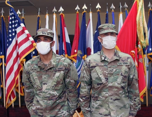 Privates 2nd Class Carlos Fontanez, left, and Ari Till wear their new ranks after being promoted Sept. 18 at Fort Sill, Oklahoma. (Fort Sill)