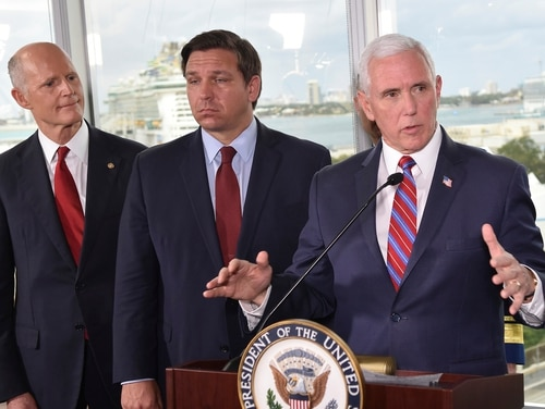 Vice President Mike Pence, right, along with Florida Sen. Rick Scott, left, and Gov. Ron DeSantis, center, speaks to the media after a meeting with cruise line company leaders to discuss the efforts to fight the spread of the COVID-19 coronavirus, at Port Everglades, Saturday in Fort Lauderdale, Fla. (Gaston De Cardenas/AP)