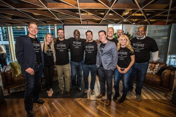 Members of the first cohort of WeWork Veterans in Residence members gather for a picture at their office location in Denver. Through its expansion of the program, WeWork hopes to reach 1,000 veterans and military spouses over the next five years. (Photo provided by WeWork)