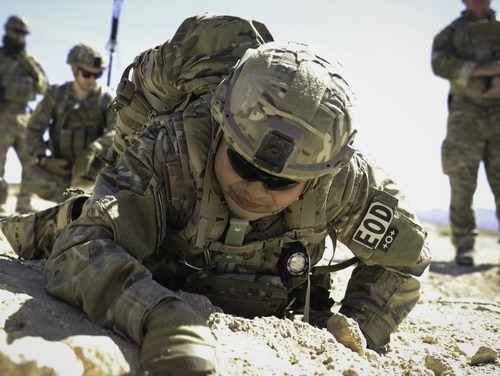 Tech. Sgt. Kenneth Westrum, an explosive ordnance disposal technician from the 99th Civil Engineer Squadron, and his team search for a wire during a training operation at Nellis Air Force Base, Nevada, in May 2017. The Air Force earlier this month tested gender-neutral, job-specific standards for EOD techs. (Senior Airman Kevin Tanenbaum/Air Force)