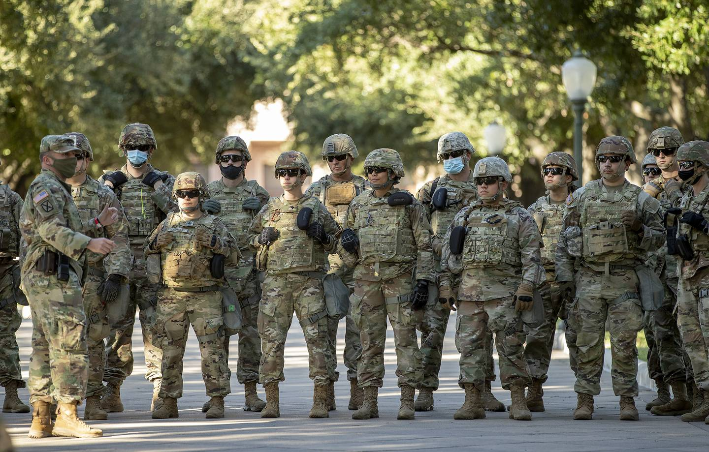 Soldiers with the Texas Army National Guard gather at the Capitol in Austin, Texas, on election day Tuesday, Nov. 3, 2020.