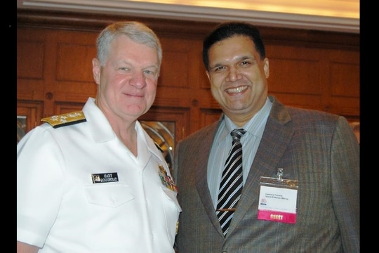 Leonard Glenn Francis poses for a photo with then-Adm. Gary Roughead, at the time chief of naval operations, during a July 3, 2008, breakfast meeting in Singapore sponsored by the Navy League of the United States Singapore Council and the American Chamber of Commerce Singapore. (Navy League of the United States Singapore Council)