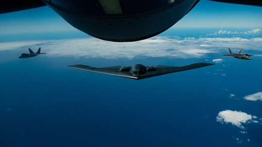 A B-2 Spirit bomber deployed from Whiteman Air Force Base, Mo., conducts aerial refueling Jan. 15, 2019, near Joint Base Pearl Harbor-Hickam (JBPHH), Hawaii, during an interoperability training mission. (Master Sgt. Russ Scalf/Air Force)