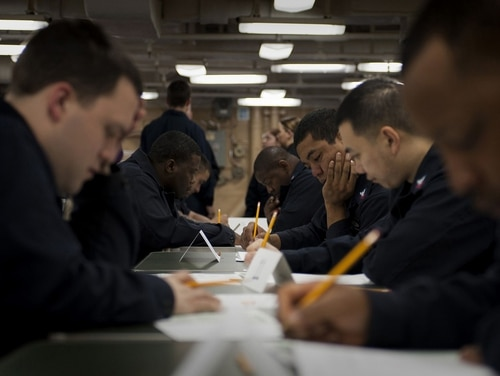 Sailors take the petty officer first class advancement exam. The Navy is introducing a new rating-specific exam that can be taken online. (MC1 Vladimir Ramos/Navy)