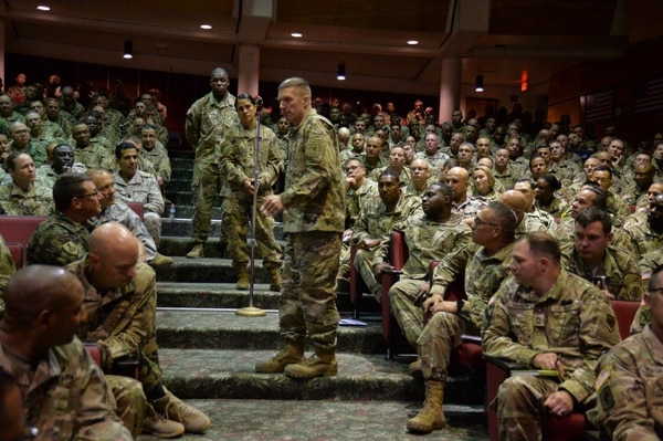Sergeant Major of the Army Dan Dailey, center, speaks with soldiers attending the U.S. Army Sergeants Major Course at the NCO Leadership Center of Excellence in April.