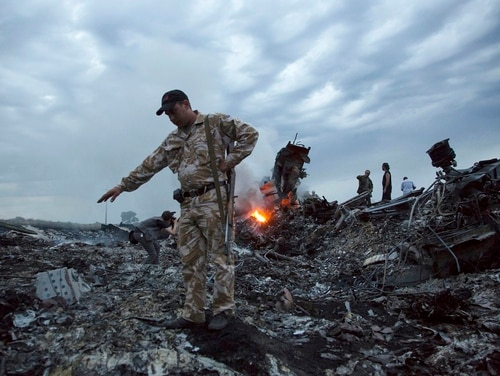 A State Department official says U.S. forces can learn a lot from Ukraine's fight with Russia and the separatists it backs, who have been accused of shooting down Malaysia Airlines Flight 17 on July 17, 2014. (Dmitry Lovetsky/AP)