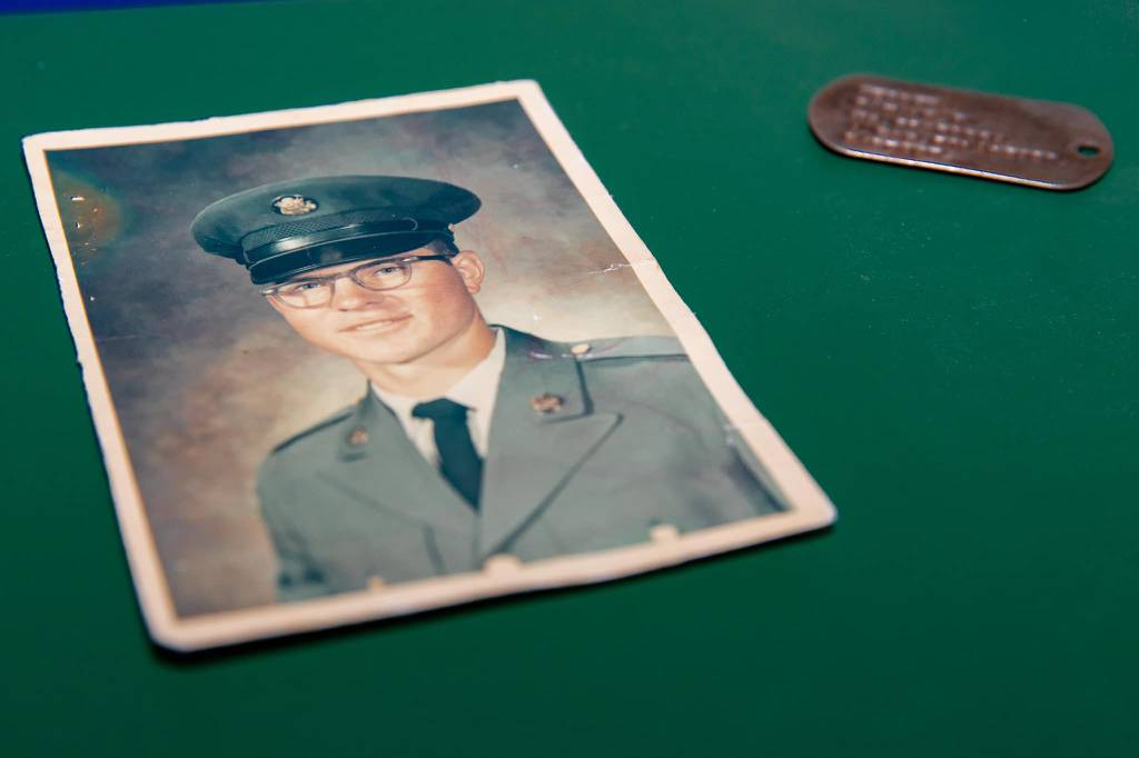 The ID tag of Vietnam War veteran and Purple Heart recipient Ron Hepper is pictured with his photo.