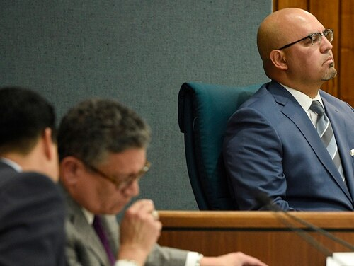 Pico Rivera City Councilman and El Rancho High School teacher Gregory Salcido, right, listens to public remarks during a city council meeting at Pico Rivera City Hall on Tuesday, Feb. 13, in Pico Rivera, Calif. (Chris Pizzello/AP)