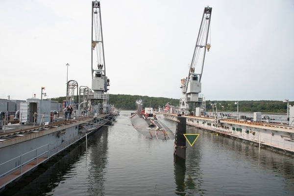 The Los Angeles fast attack submarine USS Hartford (SSN 768) is guided out of the floating dry dock, ARDM 4 on Thursday, September 17, 2020 at Submarine Base New London in Groton. Hartford completed regularly scheduled maintenance while docked. John Narewski/US Navy.