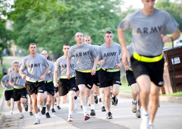 Soldiers do assorted PT - running, stretching, pushups, sit ups, medicine ball at Ft. Myer, Virginia.