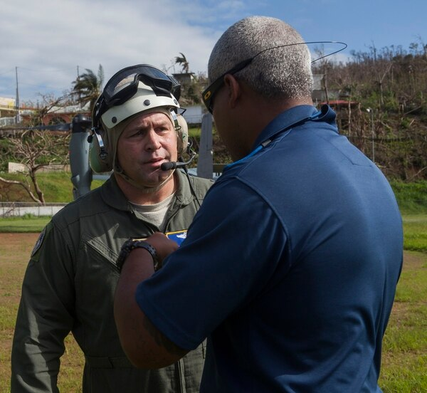 Maj. General Thomas Sharpy, deputy commander of Air Mobility Command, speaks with a local resident in Larez, Puerto Rico, Oct. 11. U.S. service members were deployed to Puerto Rico to participate in humanitarian efforts after Hurricane Maria. (Lance Cpl. Courtney T. Miner/Marine Corps)