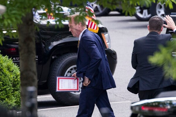 Outgoing acting Defense Secretary Patrick Shanahan arrives for a meeting with President Donald Trump about Iran carrying a folder marked secret, at the White House, Thursday, June 20, 2019, in Washington. (Alex Brandon/AP)