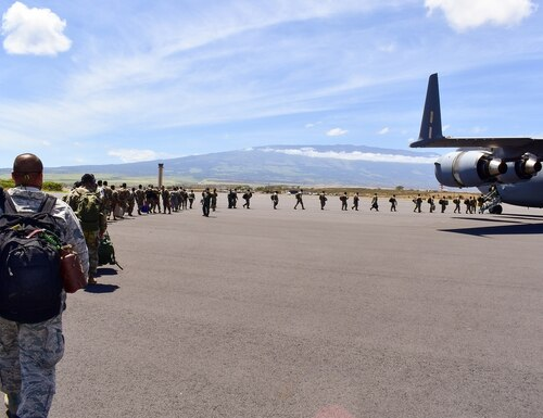 Members of the Hawaii National Guard board an aircraft home after volunteering to assist Maui County with supporting various tasks during COVID-19 operations, Kahului, Hawaii, May 28, 2020. (Sgt. 1st Class Theresa Gualdarama/Army National Guard)